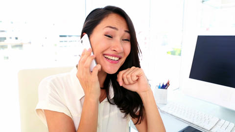 Happy businesswoman getting good news on the phone Footage