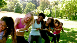 Group of fit women pulling a rope Footage