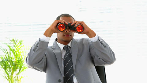 Curious businessman looking through binoculars Footage