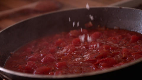 Parmesan Cheese Being Added To Frying Pan stock footage