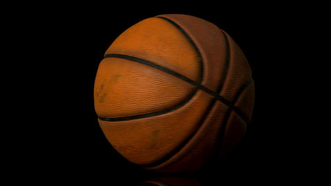 Basketball spinning on black background Footage