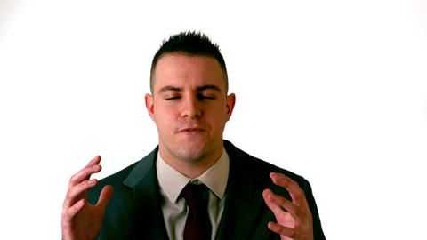 Businessman shouting at the camera on white background Footage