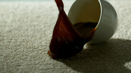 Cup of coffee falling and spilling over carpet Footage