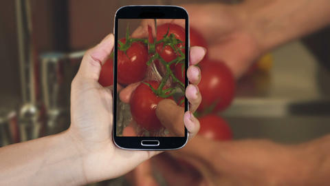 Hand showing cooking clips on smartphone Animation