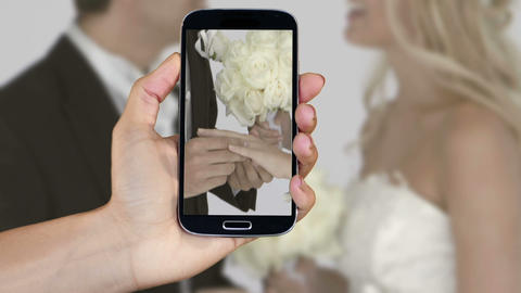 Hand showing wedding clips on smartphone Animation