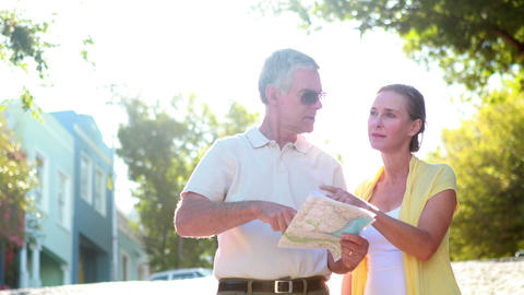 Happy Tourist Couple Reading Map And Walking stock footage