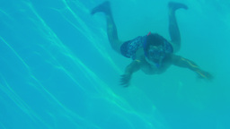 Happy man diving into swimming pool wearing a snor Footage