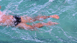 Fit swimmer doing the breast stroke in the swimming pool Footage