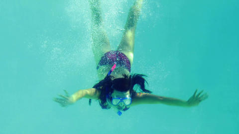 Pretty brunette diving into swimming pool wearing  Footage