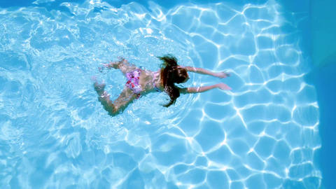 Overhead Of Brunette Swimming In Pool On Sunny Day stock footage