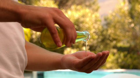 Masseuse pouring oil onto hands Footage