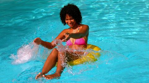 Happy woman in pink bikini having fun in inflatabl Footage