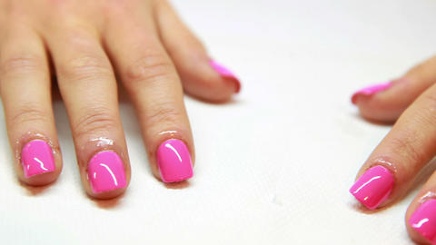 Hands showing fresh pink manicure Live Action