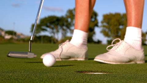 Lady Golfer Putting Golf Ball On The Green stock footage