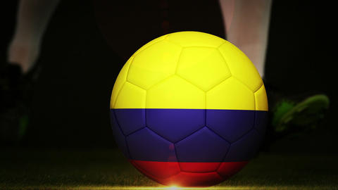 Football player kicking colombia flag ball Footage