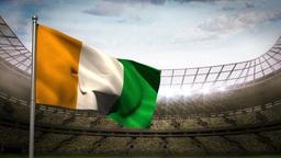Ivory coast national flag waving on stadium arena Animation