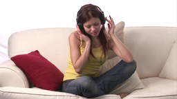 Stock Video of Woman listening to Music Footage