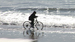 Cycling on a beach Footage