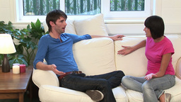 Young Couple on Sofa Arguing Live Action