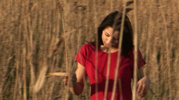 Woman in Reeds Live Action