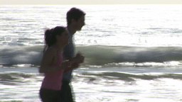 Two People Jogging along a Beach Footage