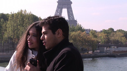 Two people next to the Eiffel Tower Footage