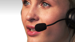 Attractive Female talking and Smiling on a headset Animation