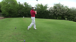 A man Teeing off in Golf Footage