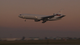 HD2009-9-35-7 DC10 landing at dusk Stock Video Footage