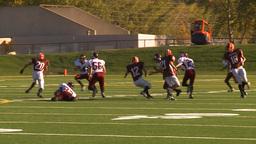 HD2009-9-36-11 high school football handoff run tackle Stock Video Footage