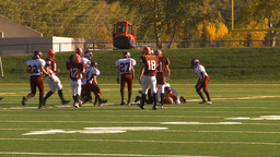 HD2009-9-36-11 high school football handoff run tackle Stock Video Footage