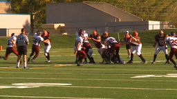 HD2009-9-36-23 high school football huddle huge pass flag... Stock Video Footage