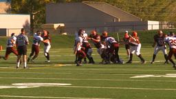 HD2009-9-36-23 high school football huddle huge pass flag... Stock Video Footage