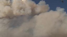 HD2009-9-37-3 Forest fire heavy smoke follow helo reveal Stock Video Footage