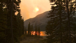 HD2009-9-38-6 lake and forest smoky red Stock Video Footage