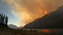 HD2009-9-38-10 forest fire smoky red sky pan Stock Video Footage