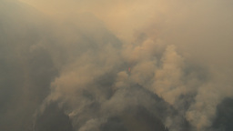HD2009-9-39-4 aerial forest fire flying into fire Stock Video Footage