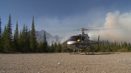HD2009-9-39-8 forest fire w helo on ground idle Footage