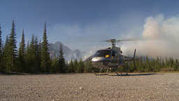 HD2009-9-39-8 forest fire w helo on ground idle Stock Video Footage