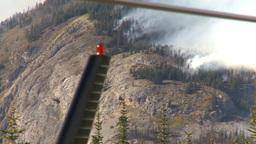 HD2009-9-39-14 forest fire heavy smoke follow distand helo Stock Video Footage