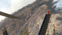 HD2009-9-39-14 forest fire heavy smoke follow distand helo Stock Video Footage