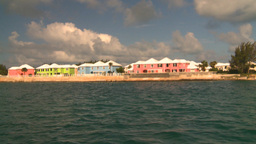 HD2008-8-12-5 cruising on water pink houses Stock Video Footage
