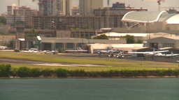HD2008-8-14-4 San Juan airport commuter aircraft landing Stock Video Footage