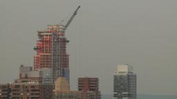 HD2008-8-19-23 city scape constr crane aerial Footage