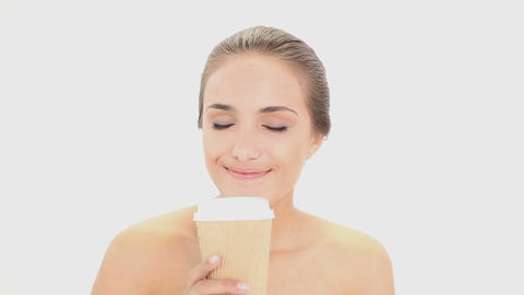 Beautiful model drinking from disposable cup Footage