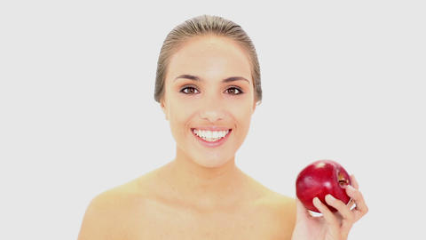 Beautiful model holding an apple Footage
