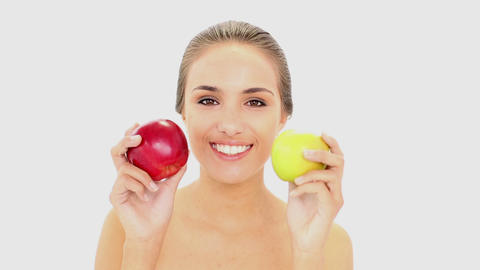 Beautiful model holding red and green apples Footage