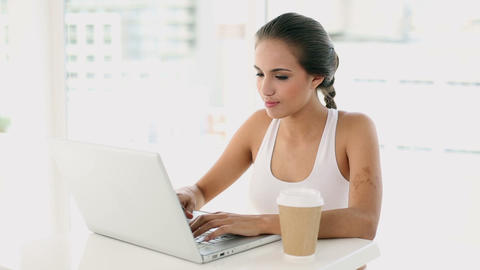 Beautiful Young Woman Using Her Laptop stock footage