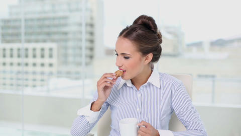 Young Businesswoman Having A Coffee Break At Her D stock footage