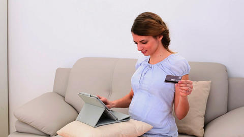 Pregnant woman shopping online with her tablet pc  Footage